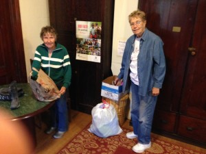 ECW members Rosemary Kverek and Maureen Lavely sort through recent donations.