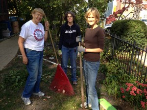 From left to right: Maureen Lavely, Kathleen Steen-Walsh, and Melissa Giese pause in the midst of their garden work.
