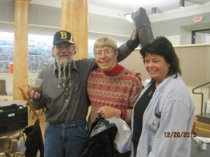 Maureen Lavely is thanked by members of the MANNA Program for the donation of blankets.