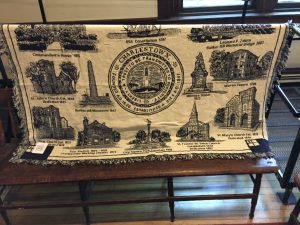 The throw depicts historic landmarks in Charlestown, including our own St. John's.